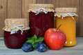 Jam jars and fruits Royalty Free Stock Photo