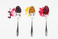 Jam mixed berry apricot and sour cherry on spoons Royalty Free Stock Images