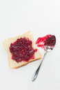 Jam slice of toast with cherry and spoon Royalty Free Stock Photography