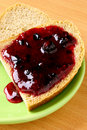 Jam spread on bread Stock Image