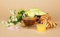 Jam tea bagels and honey a branch of jasmine linden rose petals on a beige background Stock Photo