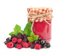 Jam and wild berries Stock Photos