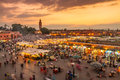Jamaa el Fna market square in sunset, Marrakesh, Morocco, north Africa. Royalty Free Stock Photo