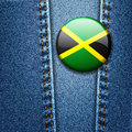 Jamaica Flag Badge On Jeans Denim Texture Stock Images