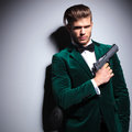 James bond wannabe young assasin with a big pistol in his hand Royalty Free Stock Photos