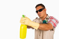 James cleaning bond spanish man spraying for clean his house Royalty Free Stock Photography