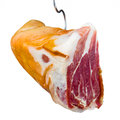 Jamon meat is hanging on hook white background Stock Photos