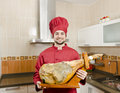 The jamon serrano chef with pig leg spanish typical product form spain Royalty Free Stock Photo