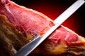 Jamon serrano. Slicing hamon iberico Royalty Free Stock Photo