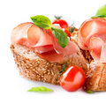 Jamon slices bread spanish serrano ham over white Royalty Free Stock Image
