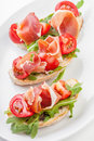 Jamon. Slices of Bread with Spanish Serrano Ham Royalty Free Stock Photo