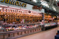 Jamones delicatessen stall at the mercado central valencia spain may a young people stand a with local speciality dried hams a Royalty Free Stock Photo