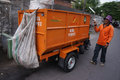Janitor uses a three wheeled motorcycle to transport the waste in the city of solo central java indonesia Stock Image