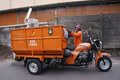 Janitor uses a three wheeled motorcycle to transport the waste in the city of solo central java indonesia Stock Photos