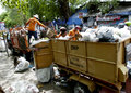 Janitor was cleaning the garbage on the streets in the city of solo central java indonesia Royalty Free Stock Photography