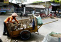 Janitor was cleaning the garbage on the streets in the city of solo central java indonesia Royalty Free Stock Photo