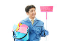 Janitorial cleaning service ethe male worker who poses happily on white background Royalty Free Stock Image