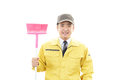 Janitorial cleaning service the male worker who poses happily on white background Royalty Free Stock Photos
