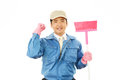 Janitorial cleaning service the male worker who poses happily on white background Stock Photo