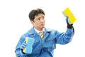Janitorial cleaning service the male worker who poses happily on white background Stock Photography