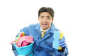Janitorial cleaning service the male worker who poses happily on white background Royalty Free Stock Image