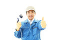 Janitorial cleaning service the male worker who poses happily on white background Stock Images