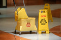 Janitorial mop and caution sign on hallway Royalty Free Stock Photos