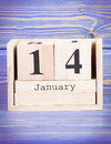 January 14th. Date of 14 January on wooden cube calendar