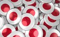 Japan Badges Background - Pile of Japanese Flag Buttons. Royalty Free Stock Photo