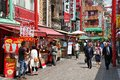 Japan kobe april visitors enjoy sunny weather in chinatown on april in nankinmachi s chinatown is the nd largest Stock Photography