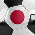 Japan soccer ball close up view of a with the japanese flag on it Royalty Free Stock Photos