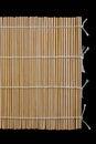 Japanese bamboo sushi mat isolated on black Stock Photography