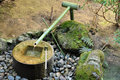 Japanese bamboo water fountain traditional and old Stock Image