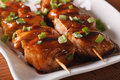 Japanese barbecue: yakitori chicken on a plate close-up. horizon Royalty Free Stock Photo