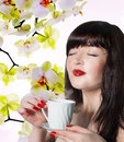 Japanese beautiful girl with a cup aromatic beverage Royalty Free Stock Photos