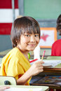 Japanese boy in elementary school smiling class at his desk Royalty Free Stock Image