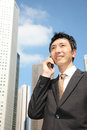 Japanese businessman talks with a mobile phone Royalty Free Stock Photo