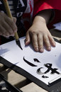 Japanese calligraphy a traditional artist demonstrating this art in a public demonstration in bucharest romania Stock Images