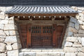 Japanese castle gate closed and rock wall Stock Photography