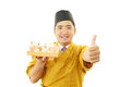 Japanese chef showing thumbs up sign portrait of a sushi isolated on white background Stock Images