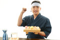 The japanese chef who poses happily portrait of a sushi isolated on white background Royalty Free Stock Photos