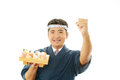 The japanese chef who poses happily portrait of a sushi isolated on white background Stock Photo