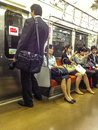 Japanese commuters on train the in tokyo Stock Photo