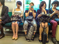 Japanese commuters on the train in tokyo Stock Photography