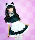 Japanese cosplay cute lolita maid it s a asia in pink background Stock Photos