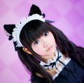 Japanese cosplay cute lolita maid it s a asia in pink background Royalty Free Stock Images