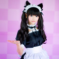 Japanese cosplay cute lolita maid it s a asia in pink background Stock Image