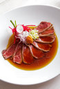 Japanese cuisine beef tataki poured with soy sauce Royalty Free Stock Photo