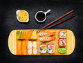 Japanese Cuisine Food with Sushi, Soy Sauce and Tsukemono Royalty Free Stock Photo