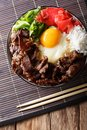 Japanese cuisine: gyudon beef with rice and onion. Vertical top Royalty Free Stock Photo
